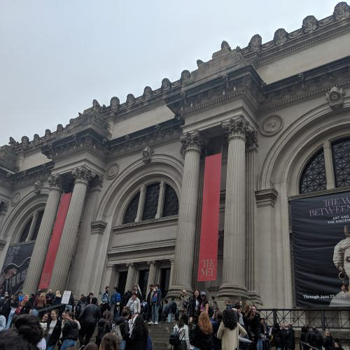 The facade of the Metropolitan Museum of Art on Fifth Avenue on a gray day in April.